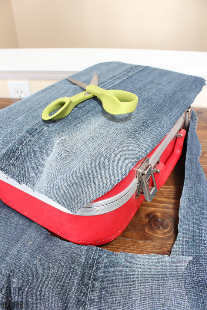 covering a suitcase with denim